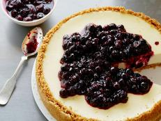 Bake Tyler Florence's Ultimate Cheesecake recipe from Food Network for a zesty-sweet classic topped with warm lemon blueberries.