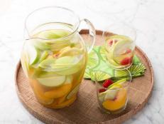 Rachael Ray's fruity and refreshing White Sangria recipe, from 30 Minute Meals on Food Network, is flavored with citrus, peaches, apples and raspberries.