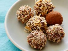 Roll Alton Brown's melt-in-your-mouth Chocolate Truffles from Food Network for a luxurious treat that works as a perfect gift.