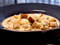 For a bowl of creamy comfort, try Dave Lieberman's New England Clam Chowder recipe from Food Network, perfect with homemade baguette croutons.