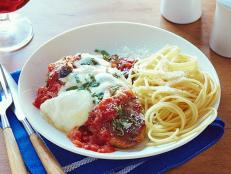 For classic Italian comfort tonight, try Tyler Florence's Chicken Parmesan recipe from Food Network.