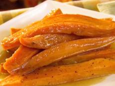 For a crowd-pleasing side dish, try Patrick and Gina Neely's Glazed Sweet Potatoes for Food Network.