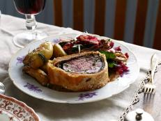 For an elegant main course, wrap tender filet mignon in buttery pastry for Tyler Florence's Ultimate Beef Wellington recipe from Food Network.