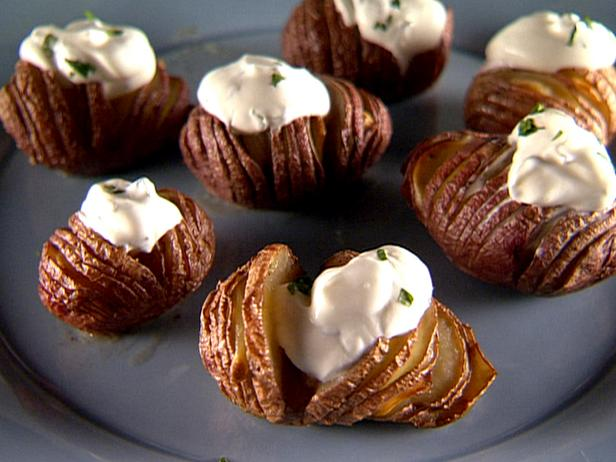 Garlic Hasselback Potatoes with Herbed Sour Cream