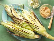 Find out the secret to Bobby Flay's Perfectly Grilled Corn on the Cob recipe from Food Network, a summer side served with homemade herb and barbecue butters.