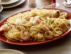 Dine seaside tonight with Tyler Florence's Shrimp Scampi with Linguini recipe from Food Network: Lemon, garlic and white wine meet hearty shrimp and pasta.