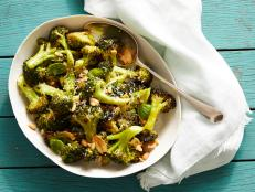 Looking for a new way to eat broccoli? Try Ina Garten's Parmesan-Roasted Broccoli, with lemon, Parmesan and pine nuts, from Barefoot Contessa on Food Network.