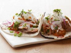 Serve Bobby Flay's healthy Fish Tacos recipe, from Boy Meets Grill on Food Network, with a fresh tomato salsa at your next party.