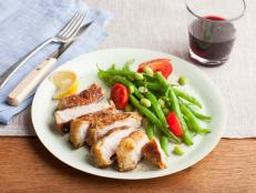 For dinner tonight, heat up a skillet for Giada De Laurentiis' Parmesan-Crusted Pork Chops recipe from Everyday Italian on Food Network.