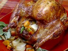 Crown your holiday feast with this Thanksgiving Pioneer-Style Herb Roasted Turkey recipe from Throwdown with Bobby Flay on Food Network.