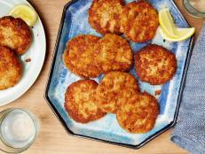 Easily add flavor to Melissa d'Arabian's budget-friendly Salmon Cakes recipe from Ten Dollar Dinners on Food Network by adding a secret ingredient: bacon.