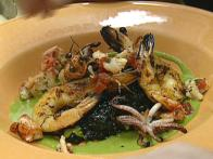Black Squid Ink Risotto with Grilled Prawns, Lobster and Green Onion Vinaigrette