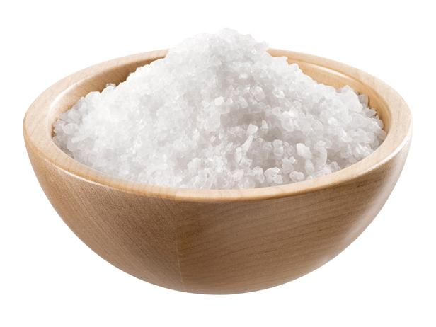 Sea salt in a  wooden bowl
