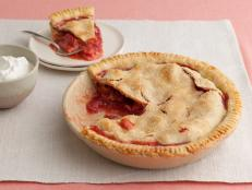 Bake Grandma's Strawberry-Rhubarb Pie recipe from Food Network. This buttery homemade crust and tangy-sweet filling is the ultimate taste of home.