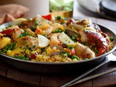 For a taste of seaside Spain, serve Tyler Florence's The Ultimate Paella recipe, an authentic rice dish studded with chicken, chorizo, clams, shrimp and lobster.
