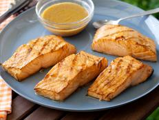 Ina Garten's Asian Grilled Salmon, from Barefoot Contessa on Food Network, is a light, quick main dish with salty-sharp flavors like Dijon and soy sauce.