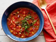 For a bright, refreshing summer soup, try Alton Brown's Gazpacho recipe, loaded with fresh, crunchy vegetables and herbs, from Good Eats on Food Network.