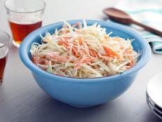 Spiked with vinegar and spiced with mustard, Bobby Flay's Creamy Coleslaw recipe is the perfect picnic side from Boy Meets Grill on Food Network.