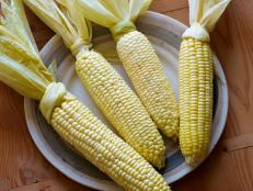 Love corn on the cob? Try roasting it whole in the oven with this easy recipe by Tyler Florence from Food Network.
