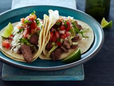Try Tyler Florence's Tacos Carne Asada recipe from Food Network: His citrusy green mojo marinade gives flank steak a real kick.
