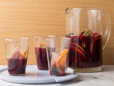For a festive gathering, mix a pitcher of Bobby Flay's Red Wine Sangria featuring pomegranates and blackberries, from Boy Meets Grill on Food Network.