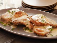 For a satisfying supper, try Tyler Florence's Smothered Pork Chops from Food Network � a creamy buttermilk gravy takes this recipe to the next level.