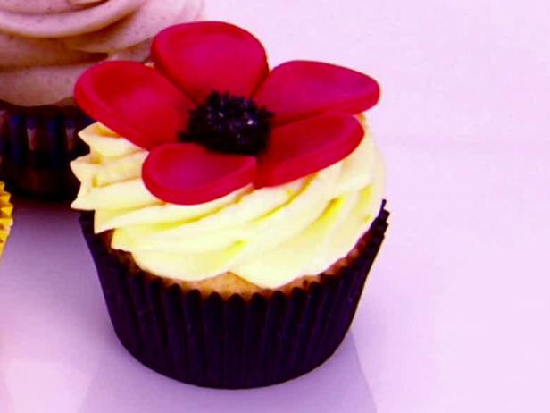 Orange Sleepy Poppy Cupcake with Spiked Orange Cream Cheese Frosting