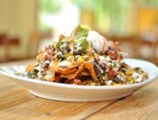 Chefs Mary Sue Milliken and Susan Feniger serve straightforward Mexican food at Border Grill, where dishes range from green corn tamales to Yucatan pork. Try the Skillet Nachos, which feature scratch-made tortilla chips and cheese sauce, organic black beans and tender morsels of carne asada.
