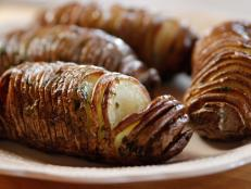 Find out how to make Ree Drummond's crisp and buttery Hasselback Potatoes from Food Network.
