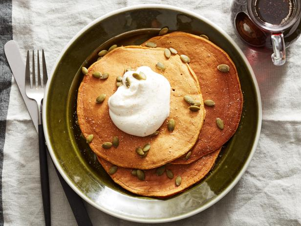 Pumpkin Pancakes with Maple Syrup and Nutmeg Whipped Cream