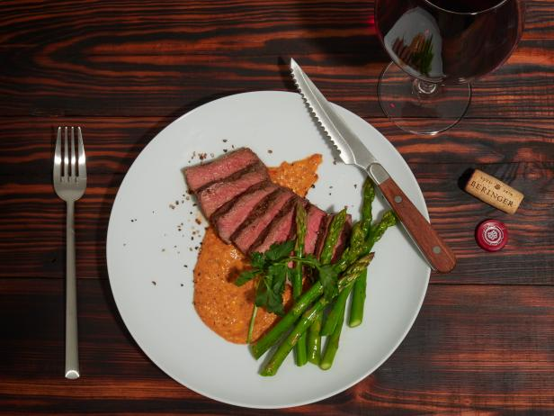 Grilled New York Strip Steaks and Asparagus with Romesco