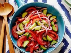 For a fresh salad standby, try Rachael Ray's Tomato, Onion and Cucumber Salad recipe from 30 Minute Meals on Food Network.