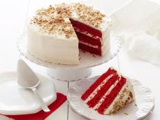 Bake a classic Southern Red Velvet Cake recipe from Food Network that's slathered in cream cheese frosting and sprinkled with crushed pecans.