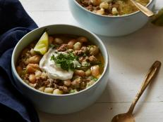 Simmer Ellie Krieger's healthy, satisfying White Chili recipe from Food Network, brimming with ground chicken, white beans and fresh poblano peppers.