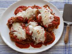 Get Ellie Krieger's healthier Chicken Parmesan recipe from Food Network. It's less cheesy and uses homemade whole-wheat breadcrumbs, but it's just as flavorful.