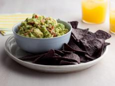 Dip into Alton Brown's kicked-up Guacamole recipe, loaded with jalapenos, tomatoes and cilantro, from Good Eats on Food Network.