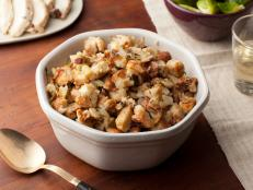 Serve Ina Garten's crowd-pleasing stuffing at your Thanksgiving feast: Herb and Apple Stuffing from Food Network.