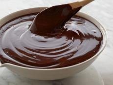 Alton Brown's recipe for two-ingredient chocolate Ganache Frosting from Food Network is decadent yet easy and the perfect topping to cakes, cupcakes and more.