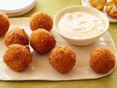 For a high-impact appetizer at your next party, serve Aaron McCargo Jr's Buffalo Chicken Cheese Balls from Big Daddy's House on Food Network.