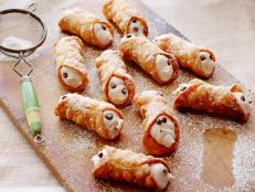 Alex Guarnaschelli's Homemade Cannoli remind her of coffee breaks in Manhattan. Best with a cup of joe, these crisp Italian shells are filled with spiced cream.