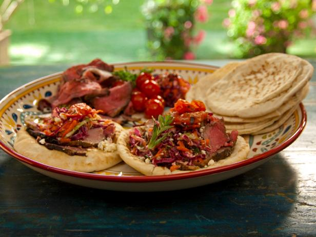 Open-Faced Pitas with Rotisserie Lamb with Pomegranate and Mint, Grilled Tomatoes, and Greek Slaw