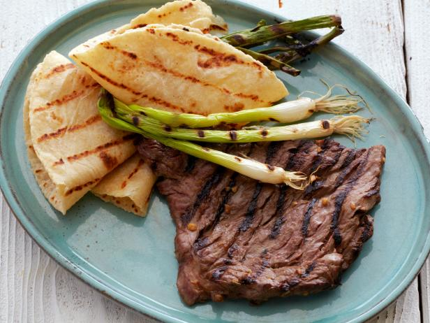 Bobby_Flay_Fit_Korean_Style_Marinated_Skirt_Steak_Grilled_Scallions_Warm_Tortillas