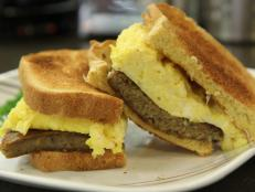"Start your day off with a hearty breakfast from Cedar Park Cafe. They have multiple kinds of scrapple, the meat-and-cornmeal concoction of Philly lore, from traditional pork to the ""health-conscious"" turkey option. Jeff Mauro likes the Scrapple, Egg and Cheese breakfast sandwich."
