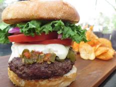 <p>The Santa Fe Bite offers a tantalizing take on the green chile cheeseburger, an iconic menu item in New Mexico. This version starts with a 10-ounce patty of chuck and sirloin, punches it up with a green chile sauce packing just the right amount of heat and pairs it with a tasty, homemade bun.</p>