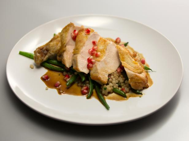 Pan-Seared Airline Chicken Breasts with Israeli Couscous, Pomegranate and Haricot Verts
