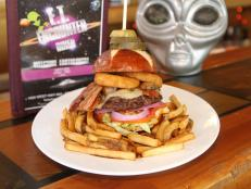 Indulge in tasty eats while letting your imagination soar at this extraterrestrial-themed restaurant. A standout is the Space Cowboy Burger, which stars 10 ounces of meaty goodness topped with Swiss cheese, mushrooms, bacon, onion rings and a special sauce. Old-school arcade games add to the fun.