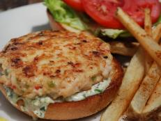Savor fresh eats and a phenomenal view at this restaurant located alongside a marina. Curtis Stone was left impressed by the Shrimp Burger. This scrumptious creation stars a pan-seared shrimp patty finished with lettuce, tomato and a cool, lemony tartar sauce, then nestled in a toasted brioche bun.