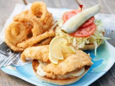 "For a fresh taste of Florida, Curtis Stone heads here for the Fried Hogfish Sandwich. It features a scallop-like white fish that is a local delicacy. The fish is filleted, battered and then fried, which gives it a ""beautiful, little-bit-of-salty crust,"" Curtis says. Also try the Sunday BBQ Plate."