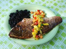 "Locals recommend getting to this popular cafe early, so that you don't miss out on the fresh seafood dishes that are switched up daily. Curtis Stone tried the catch of the day: red snapper served with a papaya-mango salsa and black rice. He raved about the combo of ""sweet salsa (and) crispy skin."""