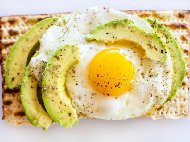 Matzoh avocado toast with egg, herbs and salt